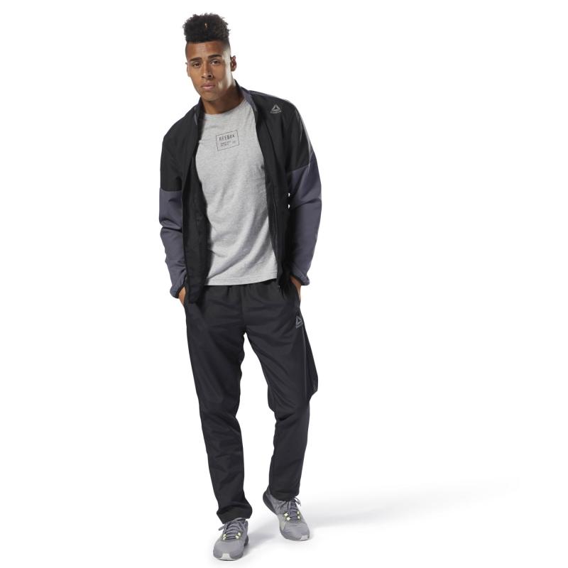 4cf59a67 Спортивный костюм REEBOK CY4926 WOVEN TRACKSUIT мужской, цвет черный,  размер 52-54 Изображение